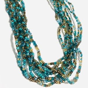 Braided beaded blues / greens necklace